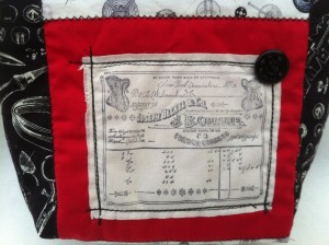 Black, white and red corset bag detail